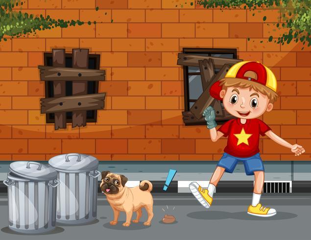 Un ragazzo prende la cacca di cane