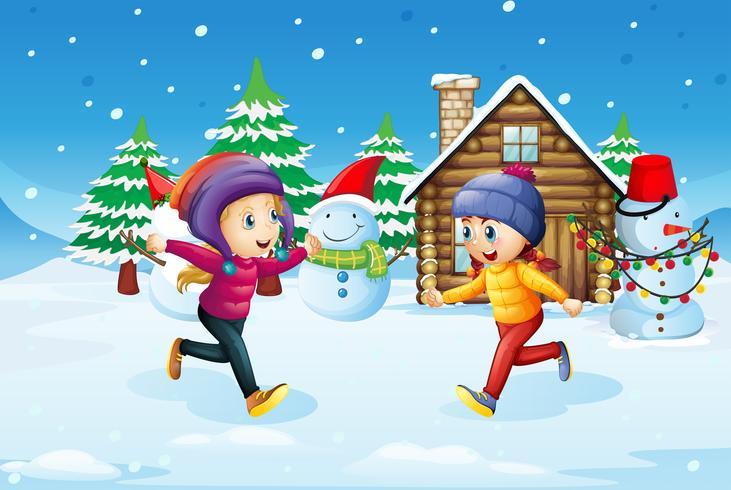Flickor leker i snö fält