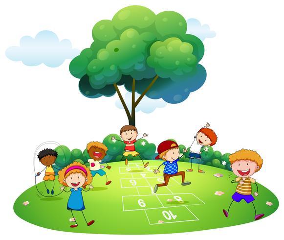 Muchos niños jugando a la rayuela en el parque