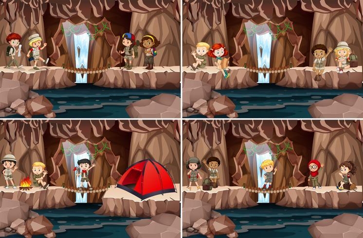 Conjunto de niños acampando en la cueva.