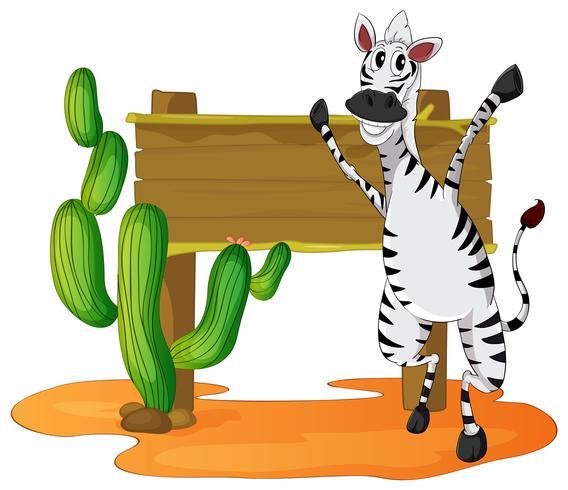 Zebra och trä tecken i öknen fält