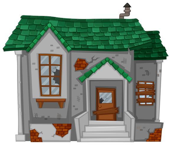 Vecchia casa con tetto verde