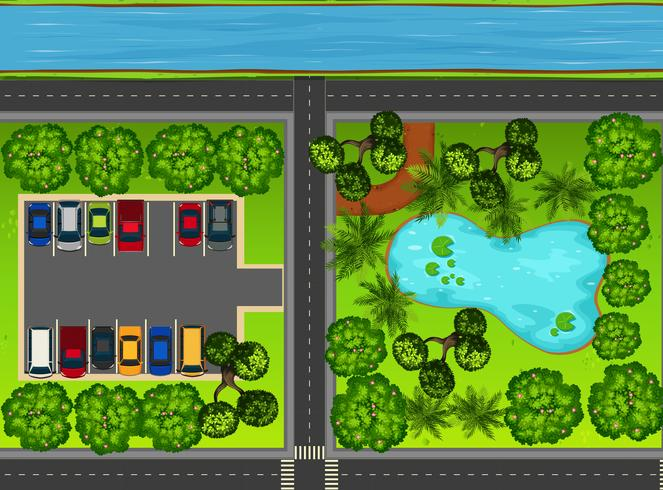 Blick auf den Park von oben mit Teich und Parkplatz