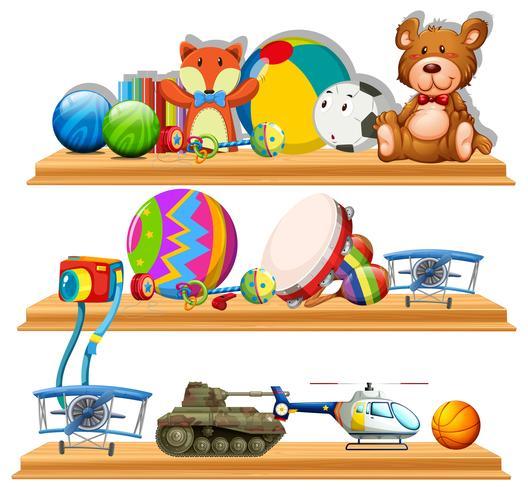 Différents types de jouets sur des étagères en bois