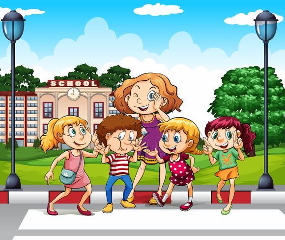Crianças e professor no chão da escola