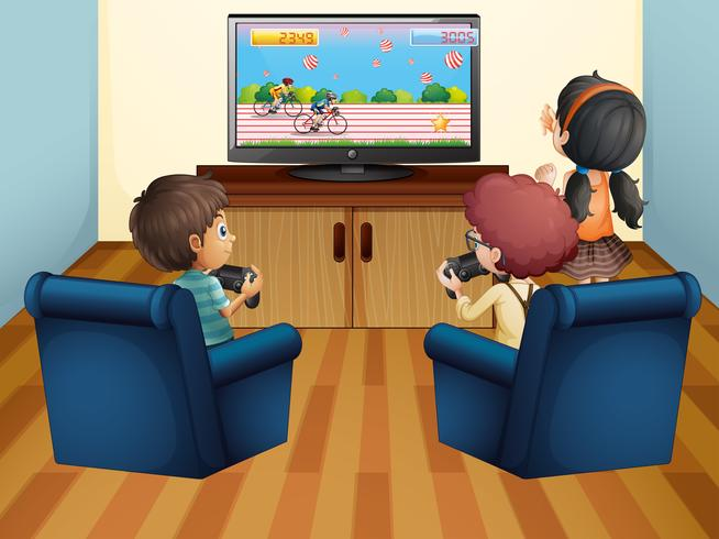 Enfants jouant à des jeux informatiques à la maison