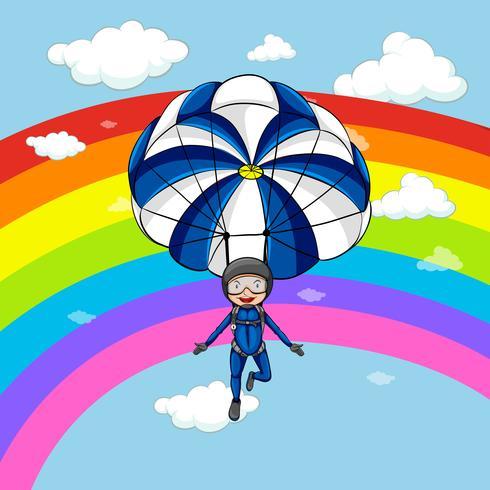 Hombre paracaidismo en el cielo con fondo de arco iris