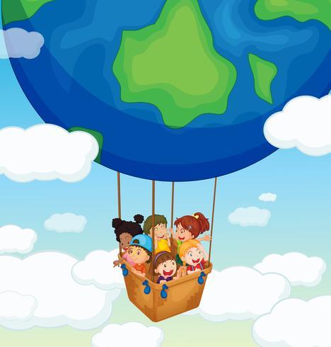 Happy kids riding on big balloon