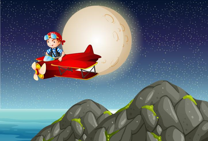 Piloto volando sobre la montaña en la noche