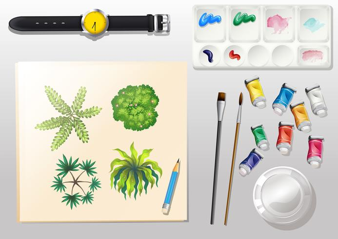 A topview of the materials for painting and a watch