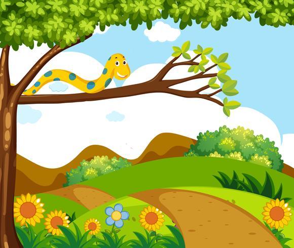Bakgrundsscen med gul orm på gren