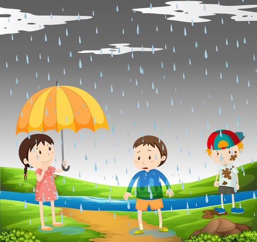 Drie kinderen in de regen