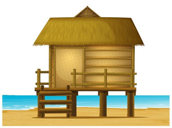 Trä bungalow på stranden