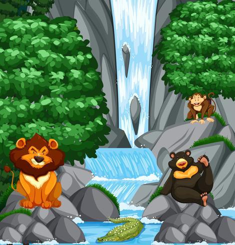Wasserfallszene mit vielen wilden Tieren