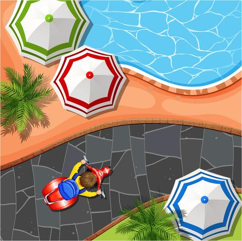 Escena aérea con piscina y parque.