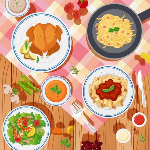 Bakgrundsdesign med olika typer av mat på bordet