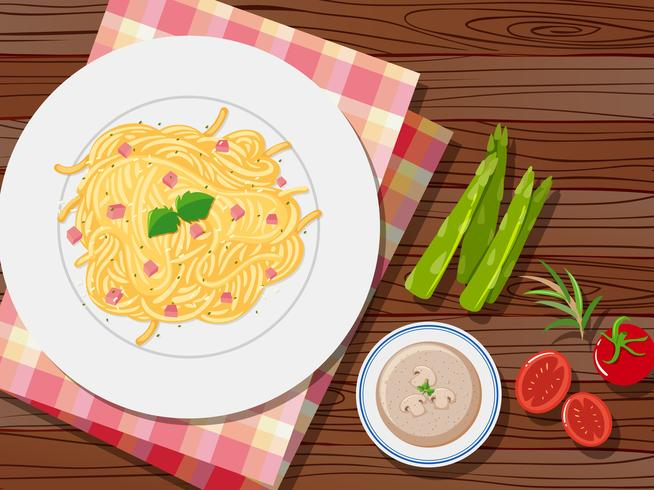 Spaghetti and soup on the table