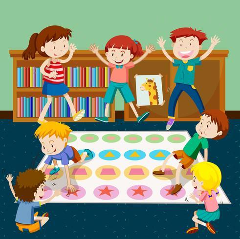Barn spelar twister i rummet