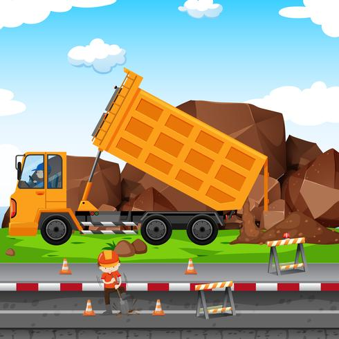 Emplazamiento de obra con hombre y tractor.