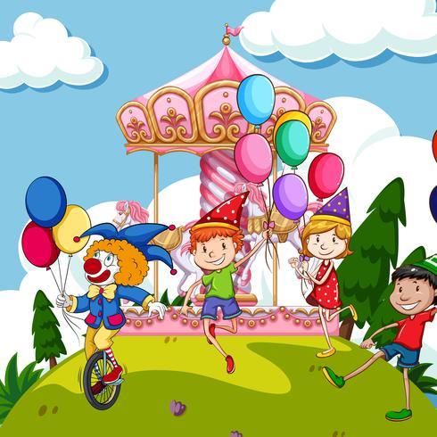 Scène met kinderen en clown bij funpark