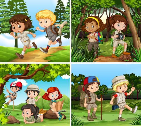 Niños caminando por el bosque.