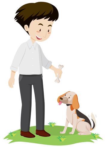 Man giving bone to dog