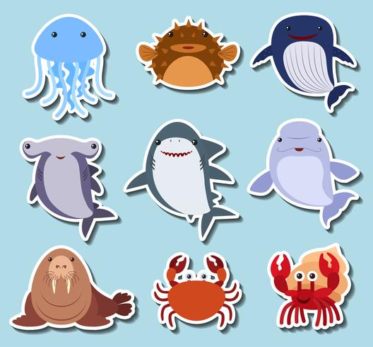 Zeedieren op blauwe achtergrond vector