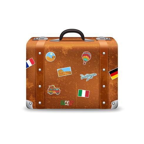 Gammal resväska med rese klistermärken vektor