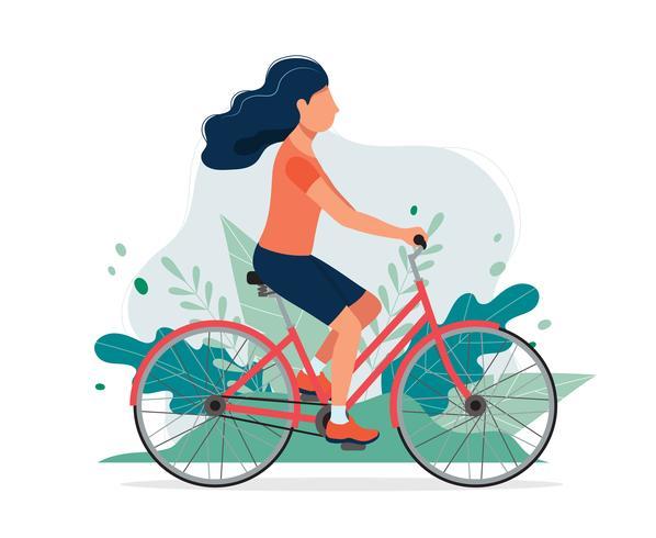 Mujer feliz con una bicicleta en el parque. Vector el ejemplo en estilo plano, ejemplo del concepto para la forma de vida sana, deporte, ejercitando.