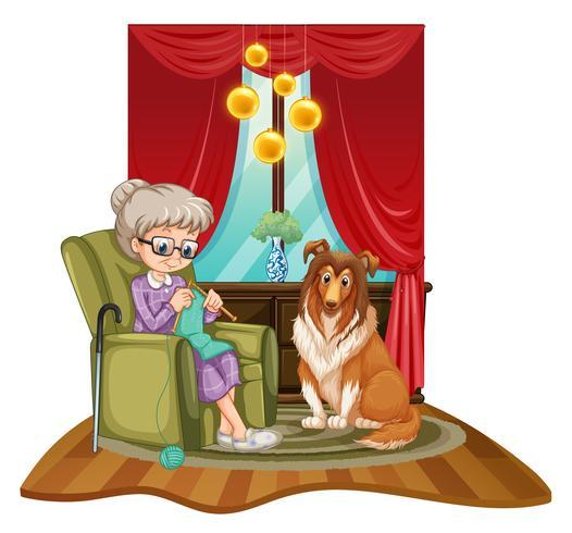 Großmutter strickt auf Sofa mit Hund neben ihr