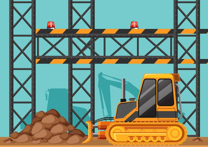 Canteiro de obras com bulldozer e barras de metal