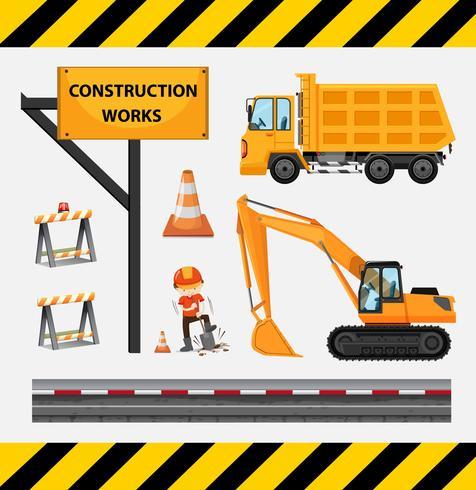 Trabalhador da construção civil e caminhões no local