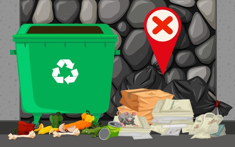 Papelera y pila de basura en la calle.