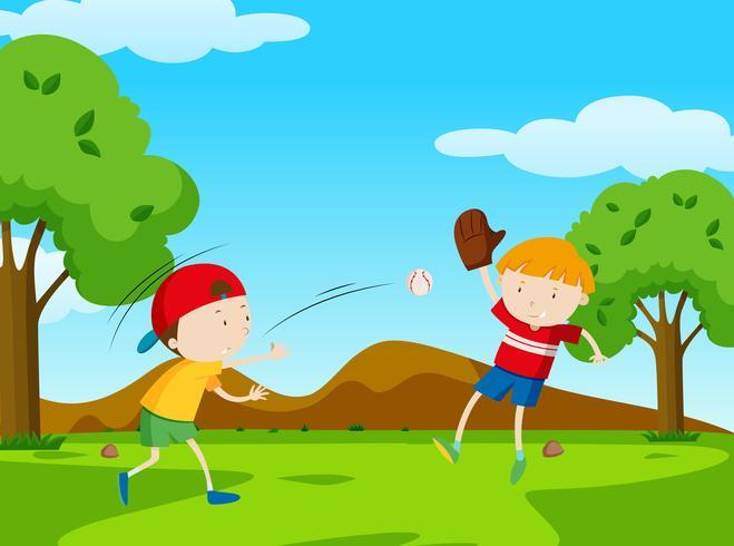 Twee jongens die honkbal in park spelen