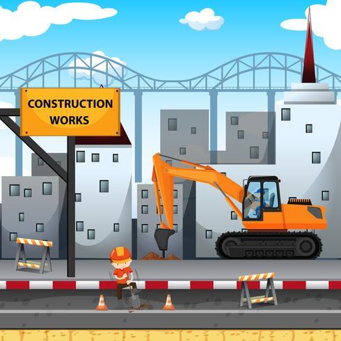 Sito di lavori di costruzione con lavoratore e trapano