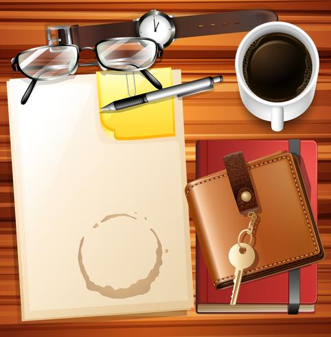 Mesa llena de papel y otros artículos de papelería.