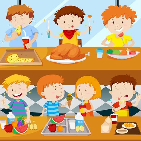 Muitas crianças comendo na cantina