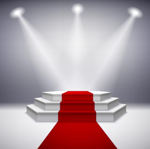 Podio escénico iluminado con alfombra roja.