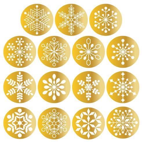 vita snöflingor på metalliska guldcirklar