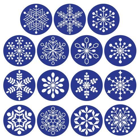 vita snöflingor på mörkblå cirklar