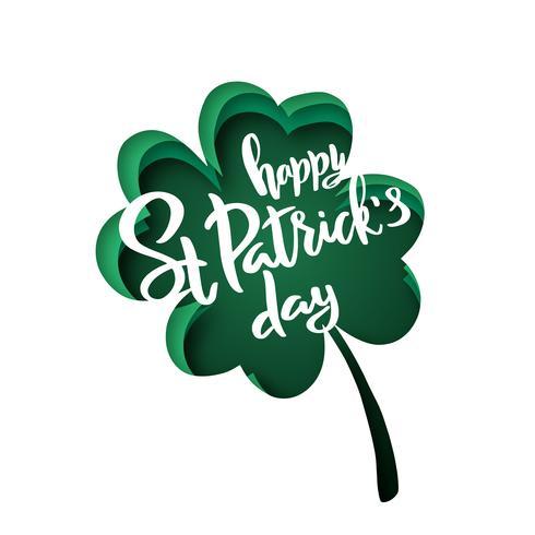 Papier découpé des formes avec la silhouette de la feuille de trèfle et inscription Happy St.Patrick Day.