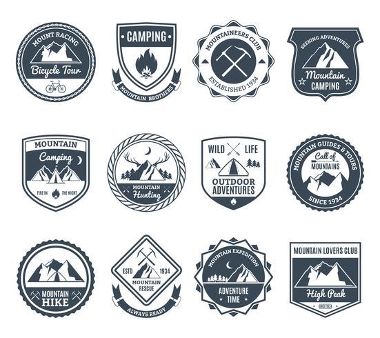 Emblemas de aventura de montaña negro vector
