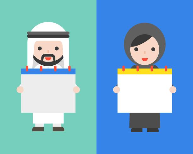 Homme d'affaires arabe et femme arabe tenant un calendrier vierge
