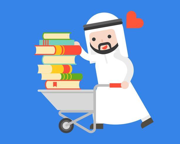 L'uomo d'affari arabo porta una pila di libro con il carretto, concetto del giorno del libro del mondo