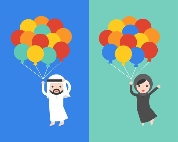 Arab businessman and woman holding balloons