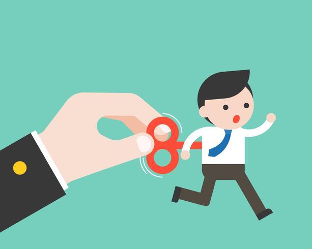 Business Hand einschalten, wickeln Sie Schlüssel des kleinen Geschäftsmannes auf seinem zurück