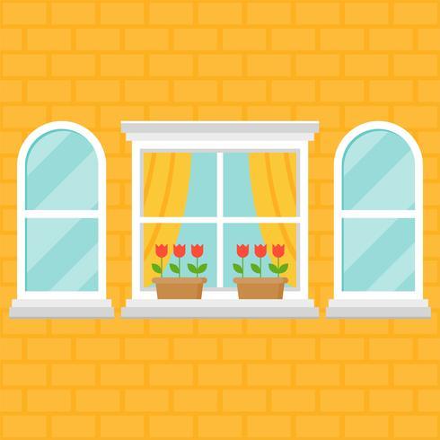 ventana y maceta en pared de ladrillo