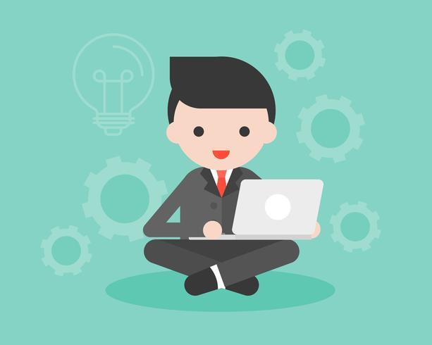 Homme d'affaires en costume noir assis avec un ordinateur portable