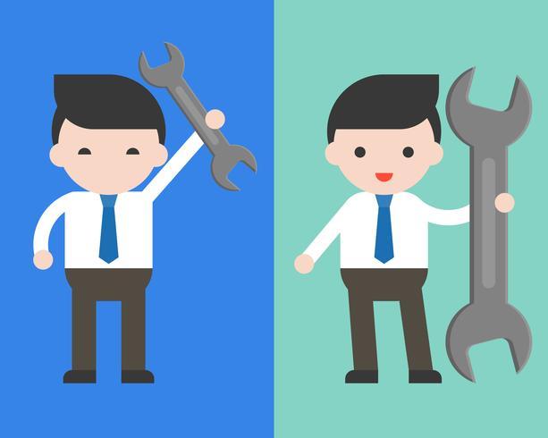 Leuke zakenman of manager met moersleutel, klaar om karakter te gebruiken
