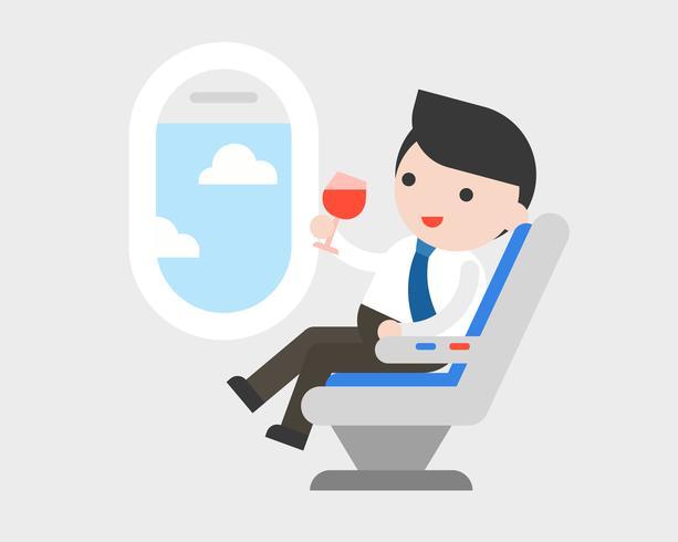 Zakenmanzitting bij zetel met glas wijn tijdens de vlucht